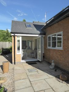Rear house extension with large windows.